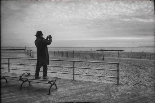 and the last image... the lone photographer capturing the surf of a new year. Complete with black fedora.