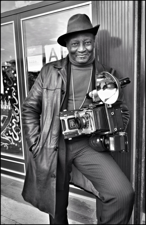 The seminal NY Street Photographer Louis Mendez covering the event.
