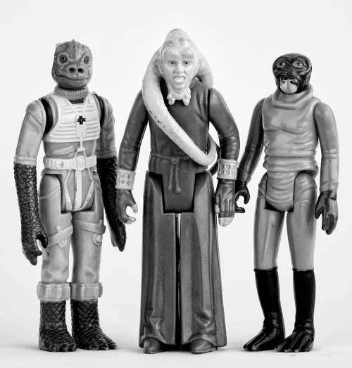 Two Bounty Hunters and Jabba's pit boss.