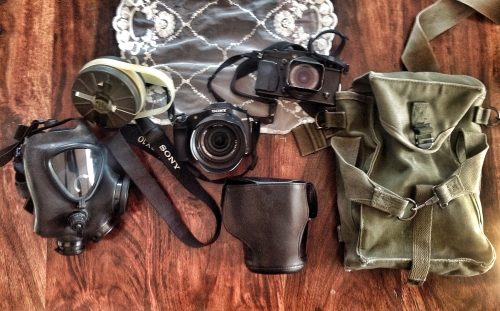 Israeli issue M15 gas mask and cartridge. Sony RX10 digital camera. Fujifilm Xpro1 with 18mm f2 lens. US issue WW2 ammo pouch.