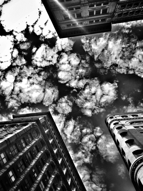 This shot was taken while I was at a stop light sitting on my Vespa. I looked up and the drama of the clouds struck me. I slipped the phone out of my pocket pointed it straight up and make this shot. It looked good in color, but the B&W was more dramatic.