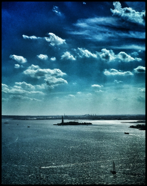 NY Harbor from a tall building in Battery Park. the Drama filter in Snapseed just really brings out the rays of light and clouds.