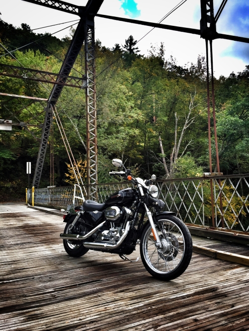 wooden bridge and harley
